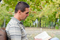 Man enjoying a book outdoors Royalty Free Stock Photo