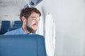 Man enjoying his journey by airplane Royalty Free Stock Photo