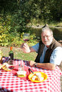 Man enjoying outdoor picnic Royalty Free Stock Photo