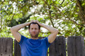Man enjoying summer with hands on his head thinking of what tomorrow holds. Royalty Free Stock Photo