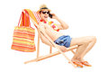 Man enjoying on a sun lounger while talking on a mobile phone isolated white background Royalty Free Stock Photos