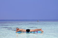 A man enjoys and an air bed on him holiday by the sea Royalty Free Stock Photography