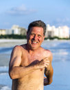 Man enjoys jogging along the beach beautiful Royalty Free Stock Photos