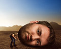 Man with enormous head in the desert Stock Photos