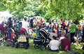 Man entertains kids on the park children during celebration of th years of clissold in north london Stock Images