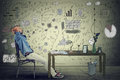 Man entrepreneur relaxing at his desk in his office Royalty Free Stock Photo