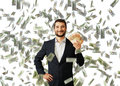 Man with euro standing under money rain successful smiley businessman and holding Royalty Free Stock Images
