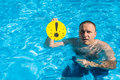 Man with an exclamation mark in the pool warning deep water Royalty Free Stock Images
