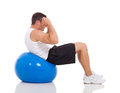 Man exercises gym ball fitness young doing on isolated on white Stock Image