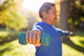 Man exercising with dumbbell Royalty Free Stock Photo