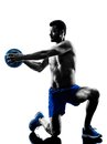 Man exercising fitness weights exercises one caucasian medicine ball in studio silhouette isolated on white background Royalty Free Stock Photos