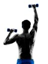 Man exercising fitness weights exercises one caucasian in studio silhouette isolated on white background Royalty Free Stock Images