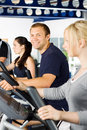 Man exercising with friends Stock Photo