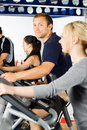 Man exercising with friends Stock Images
