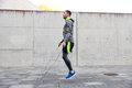 Man exercising with jump-rope outdoors Royalty Free Stock Photo