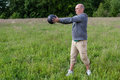 Man exercising with kilos medicine ball outdoors he is doing sport Royalty Free Stock Photo