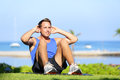 Man exercising sit ups outside male fitness model training situps exercise outdoor in summer during workout handsome fit muscular Royalty Free Stock Images
