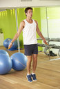 Man exercising with skipping rope in gym Royalty Free Stock Images