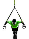 Man exercising suspension training trx silhouette one caucasian on white background Stock Image