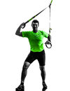 Man exercising suspension training trx silhouette one caucasian on white background Stock Photo