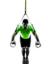 Man exercising suspension training trx silhouette one caucasian on white background Royalty Free Stock Photos