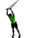 Man exercising suspension training trx silhouette one caucasian on white background Royalty Free Stock Images