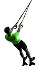 Man exercising suspension training trx silhouette one caucasian on white background Stock Photography