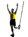 Man exercising suspension training trx silhouette one on white background Royalty Free Stock Image