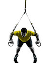 Man exercising suspension training trx silhouette one on white background Stock Images