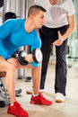 Man exercising under supervision trainer young personal Royalty Free Stock Photography