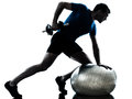 Man exercising weight training workout fitness posture one caucasian in silhouette studio isolated on white background Royalty Free Stock Photo