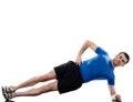 Man exercising workout fitness posture abdominals push ups lying on side on studio isolated white background Stock Image