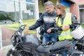 Man explaining controls motorcycle to lady Royalty Free Stock Photo
