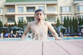 Man with eyes closed and mouth open exiting the pool Stock Photo