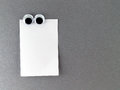 man eyes fridge magnet and blank note for text input Royalty Free Stock Photo
