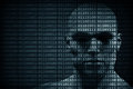 Man face blended with binary code digits. Concept of hacker, data protection etc. Royalty Free Stock Photo