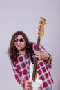Man with face expression playing electric bass guitar Royalty Free Stock Photography