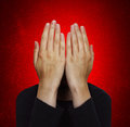 Man without a face on red backround Royalty Free Stock Photos