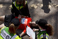 Man fainted while running the marathon london uk april has collapsed of exhaustion some meters from finish line of london and is Stock Images