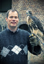 Man with falcon by old castle Royalty Free Stock Photos