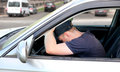 Man fall asleep in the car tired a at city crossroad Stock Images