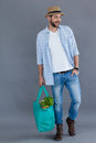 Man in fedora hat holding grocery bag Royalty Free Stock Photo