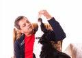 Man feeding dog with ham