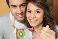 Man feeding his girlfriend strawberries Royalty Free Stock Photo