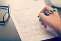 Man filling a job application form close up of Royalty Free Stock Photo