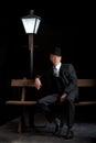 Man Film noir man lamppost bench Royalty Free Stock Photo