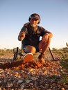 Man finding a gold nugget on the western australian goldfields using metal detector Royalty Free Stock Images