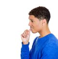 Man with finger in mouth sucking thumb closeup side view profile portrait of biting fingernail stress deep thought isolated on Stock Photos