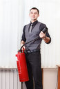 Man with fire-extinguisher in office Royalty Free Stock Photo