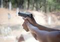 Man firing pistol at firing range Royalty Free Stock Photo